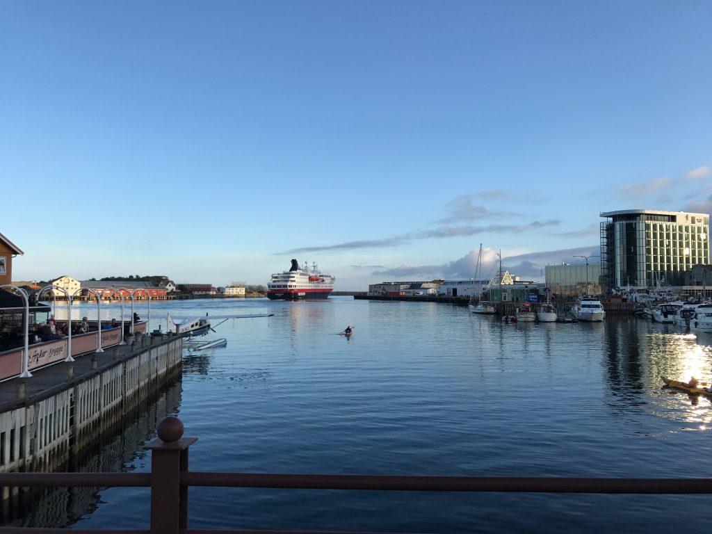 Hurtigruten leaving Svolvær harbor. The passengers of Hurtigruten will take part in the EcoArt project HESJE
